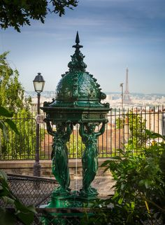 Beautiful public drinking fountain on the Montmartre butte in central Paris, France.  Wallace fountains are public drinking fountains design...