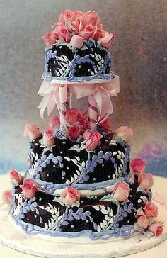 Chocolate Rosevine~  tiered wedding cake with buttercream rose vine decorated over chocolate ganache.