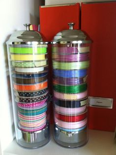 Get straw holders to store ribbon spools. Just pull up the top and the whole stack comes up, no need to remove spools to use. I also love how you can quickly see what you have.