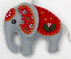 Handmade felt elephant ornament for Christmas or any occasion. Made from grey felt with hand-embroidered details in a range of colours. Please choose red, orange, green, teal, blue or purple from the Más Felt Christmas Decorations, Felt Christmas Ornaments, Handmade Ornaments, Handmade Felt, Christmas Crafts, Handmade Christmas, Handmade Crafts, Beaded Ornaments, Snowman Ornaments