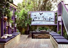 Jamie Durie's The Outdoor Room - I LOVE the bird graphic to block out the  view of neighbors... and the purple! :-)
