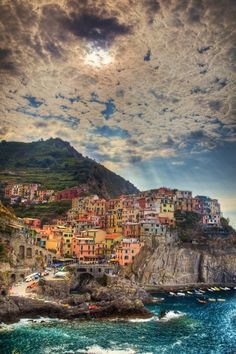 The colourful town of Cinque Terre, Italy. Come rain or shine, it's still as bright as a button. (photo via csillatomic.tumblr.com) To see hotels near the area, check out our site, here.