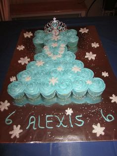 Frozen cupcake cake - First time making this pull apart cupcake cake.  Used a plunger snowflake cookie cutter for the fondant snowflakes.