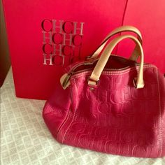 15cf1463ba0 Carolina Herrera Purse Red leather with CH   good condition just need to  clean the inside some ink marks. Comes with box and dust bag Carolina  Herrera Bags ...