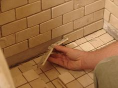 Use these step-by-step instructions to take your shower from drab to fab by installing Italian marble tile.