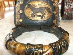 Metallic bangle and cuff by Lori Von der Puetten