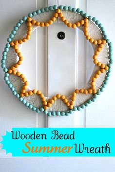 Beaded Summer Wreath! Love the scalloped edge effect with the yellow beads! #Wreath #Crafts #Beads