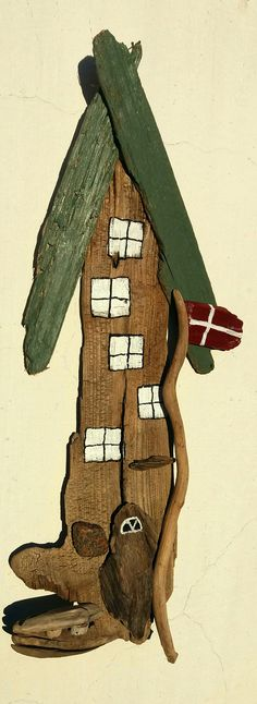 driftwood house with Danish flag. Made by EVA s.