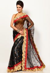 Featuring an eye-catching border, this black coloured saree from Diva Fashion will certainly make you look stunning. Made from net, this embroidered saree is light in weight and perfect for special occasions. This 5.5 m saree comes with a 0.80 m blouse piece, which can be stitched according to your taste and preference.