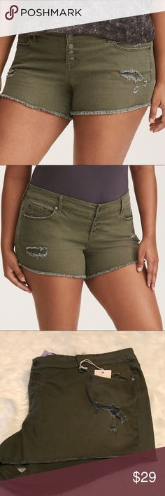 NWT Torrid skinny short shorts olive w/ button fly NWT Torrid skinny short shorts olive w/ button fly size 26. These short shorts show the most leg while still covering the right places. The four-button fly holds you in and lifts you up, complete with a frayed hem for a broken-in look. Mid-riseSkinny fit5 pocketsButton flyOlive wash torrid Shorts Jean Shorts