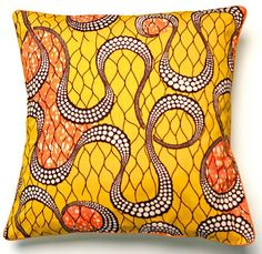 Amber and orange African print cushion - delightful!
