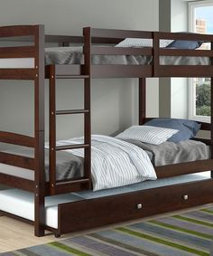 These modern bunk beds for girls or boys will help you make the most of out limited space in your child's room. They feature two twin beds with a fixed ladderf