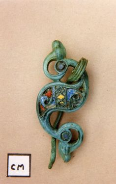 An impressive example of a complete Romano-British Dragonesque brooch. This brooch is a reversed 'S' shape in plan and is long, wide and weighs The underlying, abstract, Iron Age design is that of two cornucopias, joined Renaissance Jewelry, Medieval Jewelry, Ancient Jewelry, Celtic Clothing, Roman Britain, Roman Jewelry, Roman History, Historical Artifacts, Iron Age