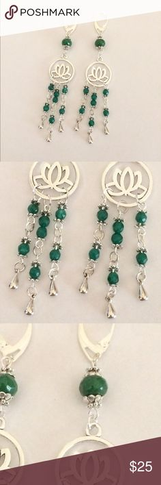 Emerald lotus chandelier earrings These are made with 925 Sterling silver lever backs. They hang 3.5 inches. Beautiful facetted natural emerald and silver accents. The lotus and silver beads are Tibetan silver. These earrings are handmade by me Jewelry Earrings