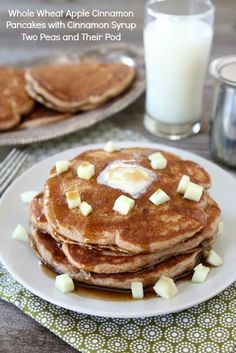 Whole Wheat Apple Cinnamon Pancakes with Cinnamon Syrup from www.twopeasandtheirpod.com #recipe #pancakes #apple