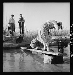 Migratory workers from Oklahoma washing in hot spring in the desert. Imperial Valley, California, 1937 - Dorothea Lange