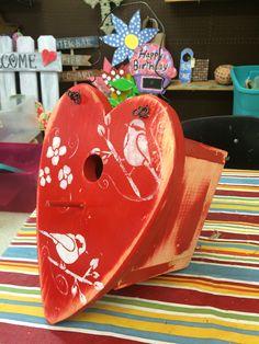 Beautiful heart-shaped birdhouse.