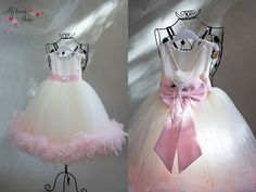 FLORAThis soft and pink and light is a little beauty of a dress will make everyone want to just touch it.The bottom of…