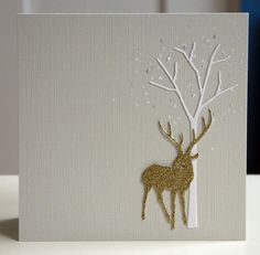 handmade Winter card ... clean and simple ...  dove gray base ... stag die cut from glitter paper and tree cut from whit cardstock .. sprinklyug on white dots and tiny Perfect Pearls falling from the top ... beautiful card!
