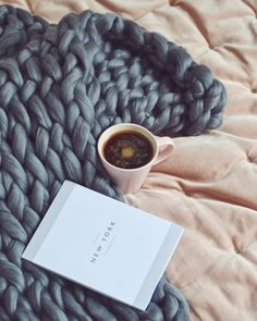 Is there anything better than  being wrapped up in a chunky knit blanket with a giant mug of coffee a large dose of wanderlust? We adore matching grey knit homeware and pink velvet interiors