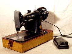 Singer Model 99K Sewing Machine With Carry Case Totally Refurbished Vintage Mid Century 1950s.  via Etsy.