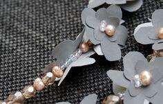 Heijastava koru on kaunis lisä laukussa tai takissa. Askartele oma heijastava koru kirsikankukkien hengessä. Katso kuvalliset ohjeet Kotiliesi.fi:stä. Diy And Crafts, Pearl Necklace, Helmet, Brooch, Pearls, Jewelry, String Of Pearls, Jewlery, Hockey Helmet