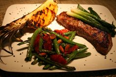 "Hibachi Kona Coffee-and-Spice Rubbed Sirloin Steak  Grilled Scallions and Maui Gold Pineapple Wedge  Dry-Sauteed Blackened Green Beans, Toasted ""Rough Chopped"" Skin-on Almonds, Blood Orange Segments  Hawaiian Black Lava Sea Salt"