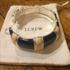 J.Crew navy & cream bangle Never used! Comes with dust bag. J. Crew Jewelry Bracelets
