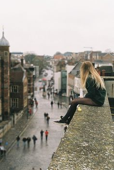 long blonde hair, sitting on the rooftop
