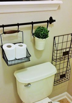 Use IKEA Curtain Rods For Over The Toilet Storage.