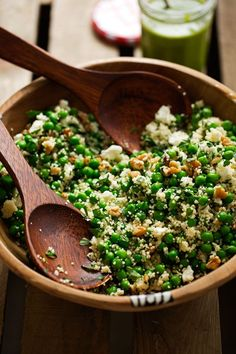 Spring Couscous Salad with Basil Vinaigrette - A simple spring salad with lots of walnuts, couscous, peas, and feta cheese. All dressed with a simple basil vinaigrette. #basilvinaigrette #peasalad #couscoussalad #vegetarian | Littlespicejar.com