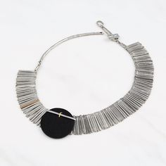 Yumia - 2016 A statement piece made for the queen you are, Yumia is a necklace created for women who are bold. Pewter fringe pieces frame your neck to unite at a large black circular piece of leather, which is detailed with a delicate metal design. Tassel Necklace, Pendant Necklace, Necklaces, Large Black, Fashion Necklace, Pewter, Bracelets, Marie, Women Jewelry
