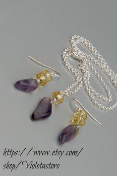 Amethyst, and crystal set of sterling silver Earrings and Necklace  Ask a Question $25.00 USD Only 1 available Overview Handmade item Materials: Sterling silver 925, Facet yellow Crystal, Amethyst stone Feedback: 2 reviews Ships worldwide from Fort Worth, Texas This shop accepts Etsy Gift Cards