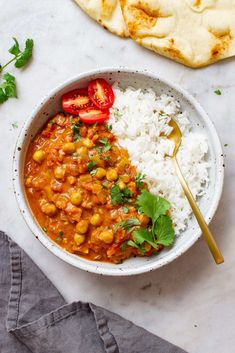 Chickpea Tikka Masala recipe - Dinner is on with this flavorful & saucy Indian inspired vegan tikka masala! It's lusciously creamy and easy to make right at home in one pan with simple ingredients! Gluten free with an oil free option.