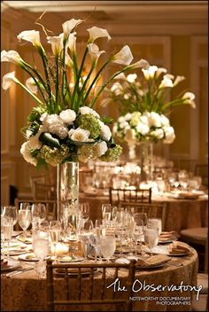 Love the height with the calla lilies. And the guests can still see each other even with this magnificent centerpiece. Love it!