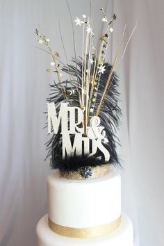 Mr. & Mrs. Gatsby black and gold feather cake topper Check out this item in my Etsy shop https://www.etsy.com/listing/263485548/mr-mrs-gatsby-black-and-gold-feather