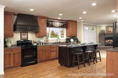 From the 2010 Tunica Show, this spacious kitchen highlights the contrast between light and dark. The gorgeous island with black wood paneling against the lighter cabinets and walls will really make a statement! Features for this home include beautifu