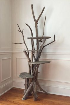40 Fun Cat Toys and Play Space Ideas Large Driftwood Cat Climbing Tree Isn't this beautiful? Its a cat tree.