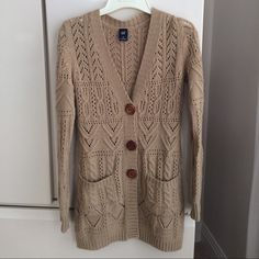 "Gap Sweater Gap Sweater camel color 30"" long. 3 wooden buttons. Acrylic/wool/alpaca/ nylon. Soft. Good used condition. Some pilling. Super cute. Size XS.  Fits S/M as well GAP Sweaters Cardigans"