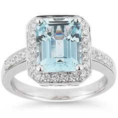 The unique and classical emerald cut accents the lights and darks of this aquamarine and diamond ring. Nested on a 14 karat white gold band, this ring has a striking beauty and elegance.