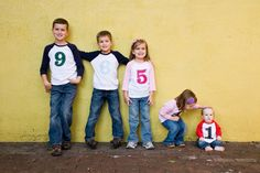 Do you ever look at photos of your kids and try to remember exactly how old they were? This is such a great idea! Baseball style tees with their ages sewn on – I LOVE the mix n' match colors paired with blue jeans. Do you think this style will look dated when your children are your age? @spearmintblogs