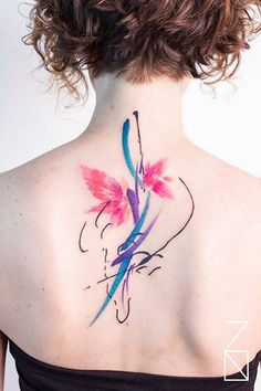 Abstract composition tattoo on the upper back.