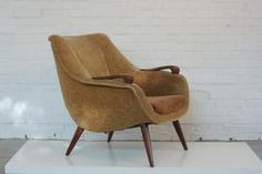 Fifties easy chair with teak armrests