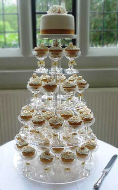 Wedding Food LOVE, LOVE, LOVE this idea! So classy and cool and will definitely keep your guests talking! :D Festive Ideas for Food « Missouri City Wedding Planner, Sugar Land Wedding Planner, Houston Wedding Planning - Cupcake Tower Wedding, Wedding Cupcakes, 50th Wedding Anniversary, Anniversary Parties, Anniversary Cupcakes, Birthday Cake 30, Champagne Party, Champagne Glasses, Champagne Cupcakes