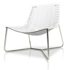 The York lounge chair (by Modloft), features carbon steel frame with laser cut natural leather seat. Measures 31 x 31 x 33. Available in multiple colors. Made in Brazil. Imported.  Available in black, white, or brown leather.