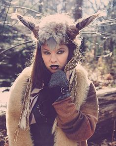 This totally unique Nordic Shaman/Warrior headdress is truly magnificent. It has long feather horns with a braided base. The leather band