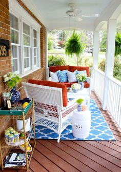 A charming southern front porch in blue, white and terracotta colors