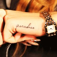Lana's paradise tattoo.