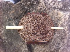 Geometrical hand carved leather hair barrette by DIONESAMBROZIUS