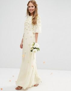 "ASOS BRIDAL Scattered 3D Floral Flutter Sleeve Maxi Dress £180.00 Midweight lined chiffon Crew neckline Beaded 3D embellishment Flared flutter sleeves Open keyhole back Button fastening  Zip closure to back Regular fit - true to size Hand wash 100% Polyester Our model wears a UK 8/EU 36/US 4 and is 175cm/5'9"" tall"